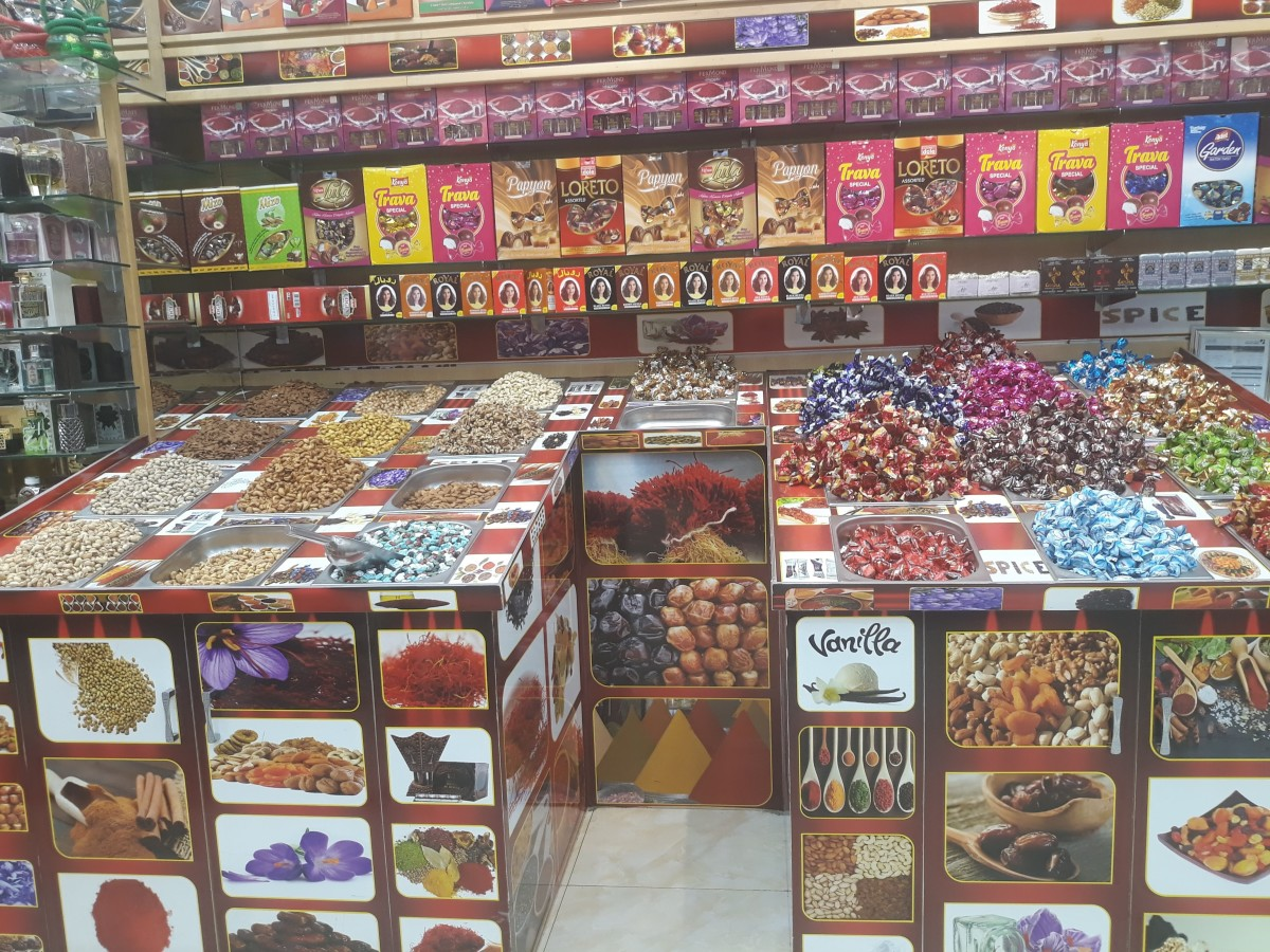 storefront in Dubai Spice Market with a variety of colorful candy, spices and saffron