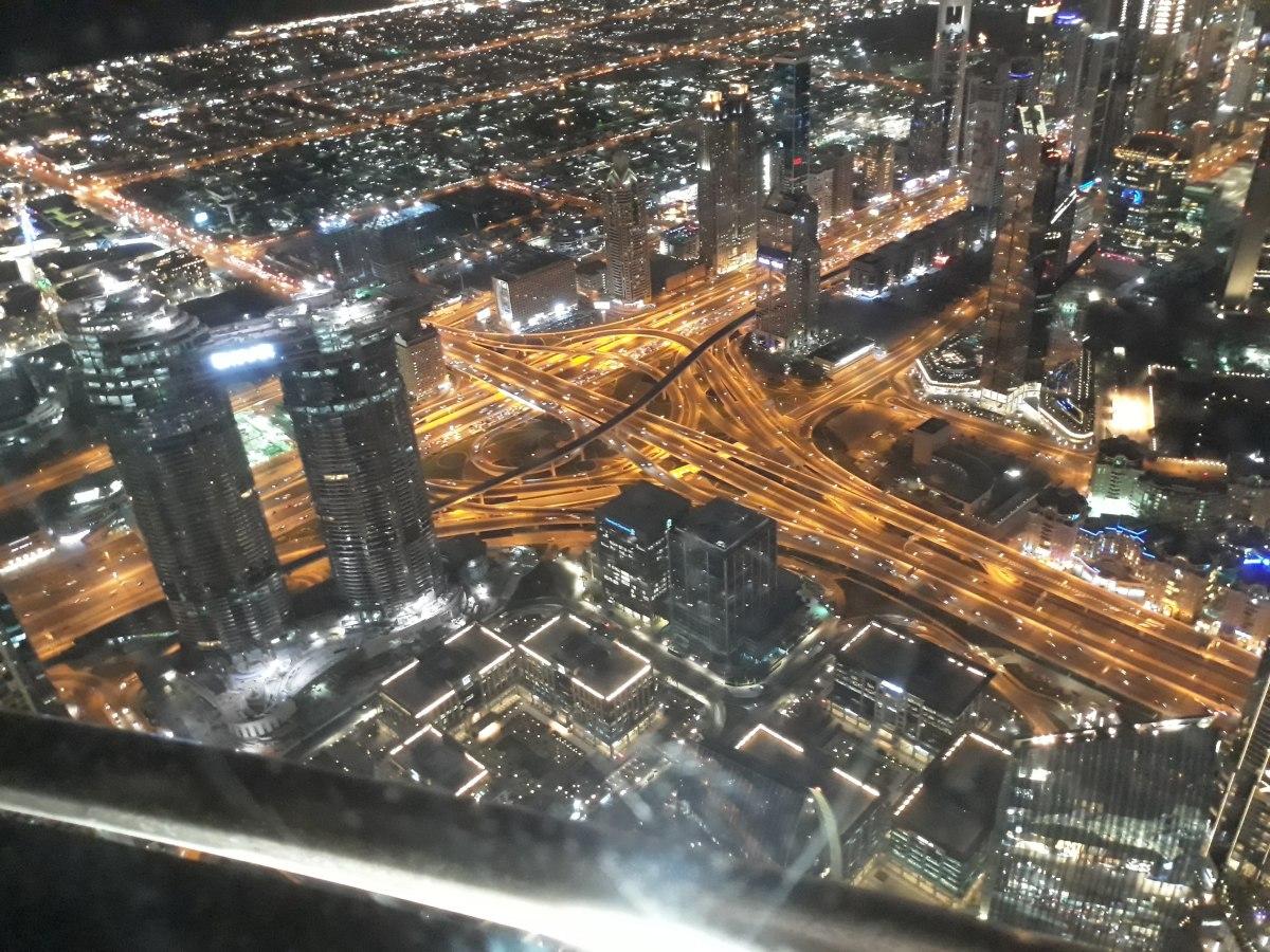 Dubai city lights viewed from Burj Khalifa Observation Deck on the 124th Floor