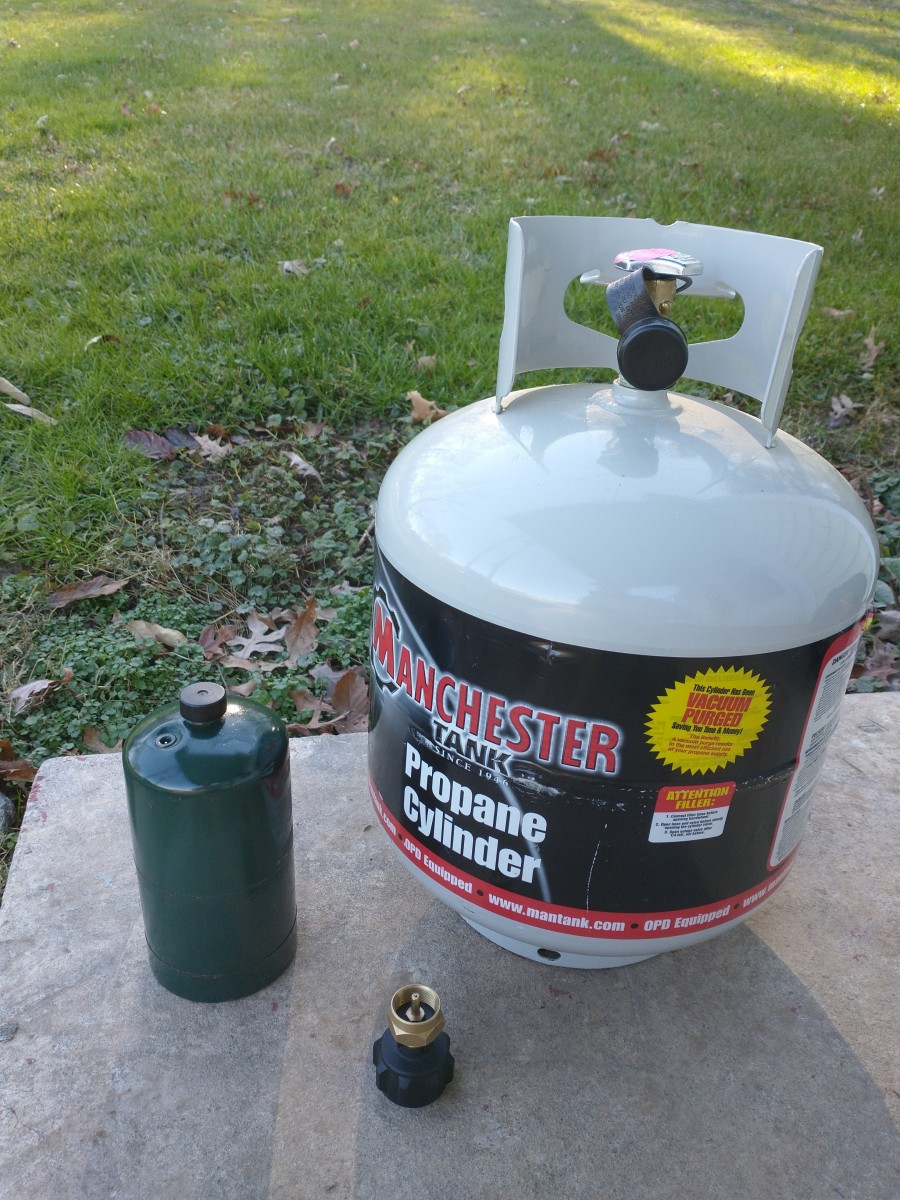 Propane tank, 1 lb. cylinder, and refill adapter.