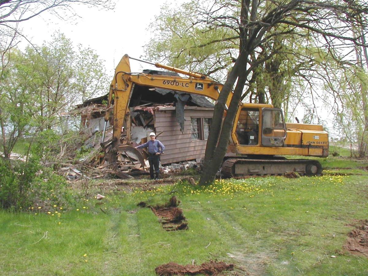 1184 Lakeshore Rd. being demolished with me standing in front of the cottage in 2004. Note that this was the last cottage to be demolished along the Burlington Beach Strip.