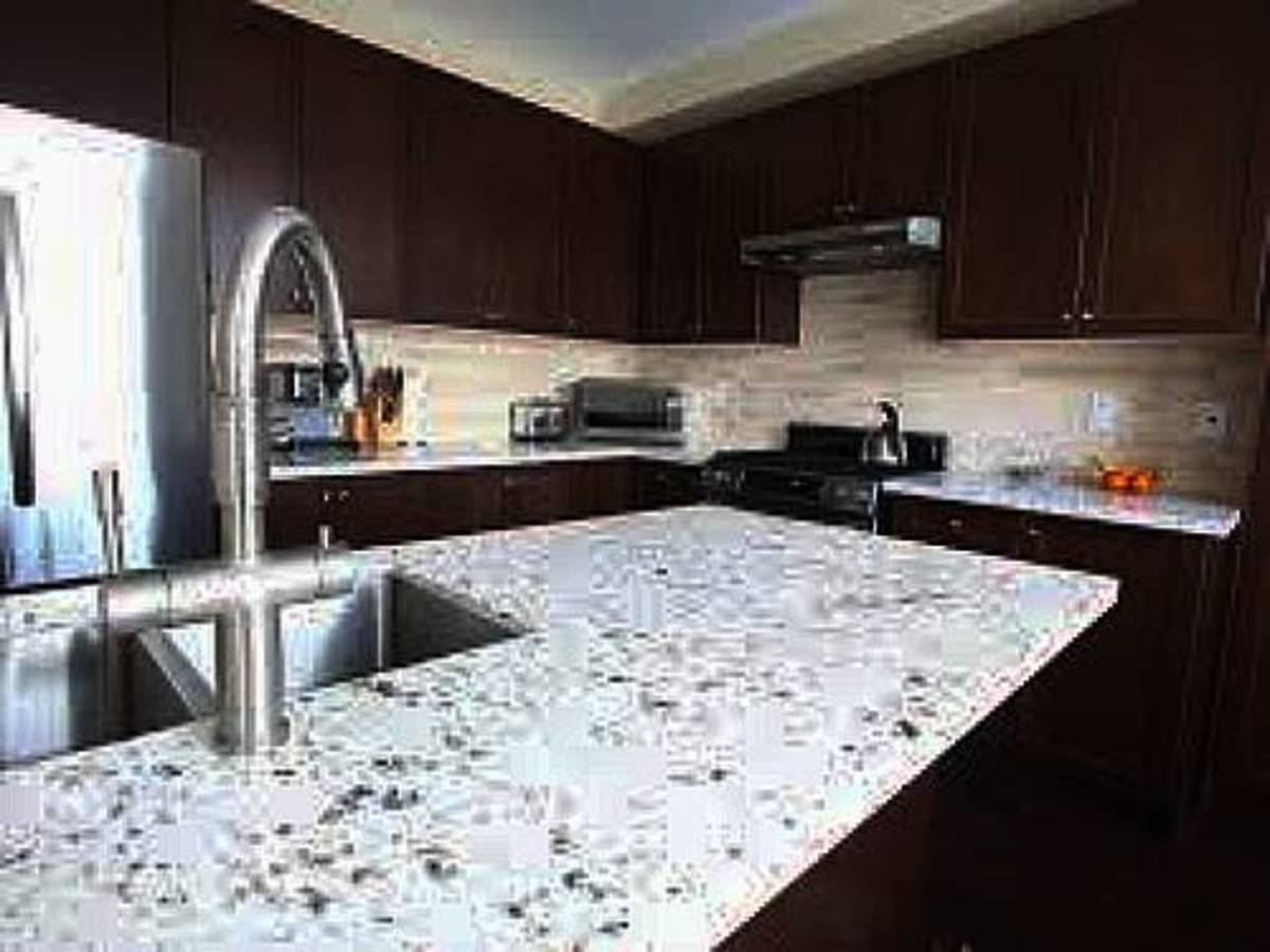 Natural quartz have been mined. The  dust aggregate is fused with pressure heat resin binders for the solid slab.
