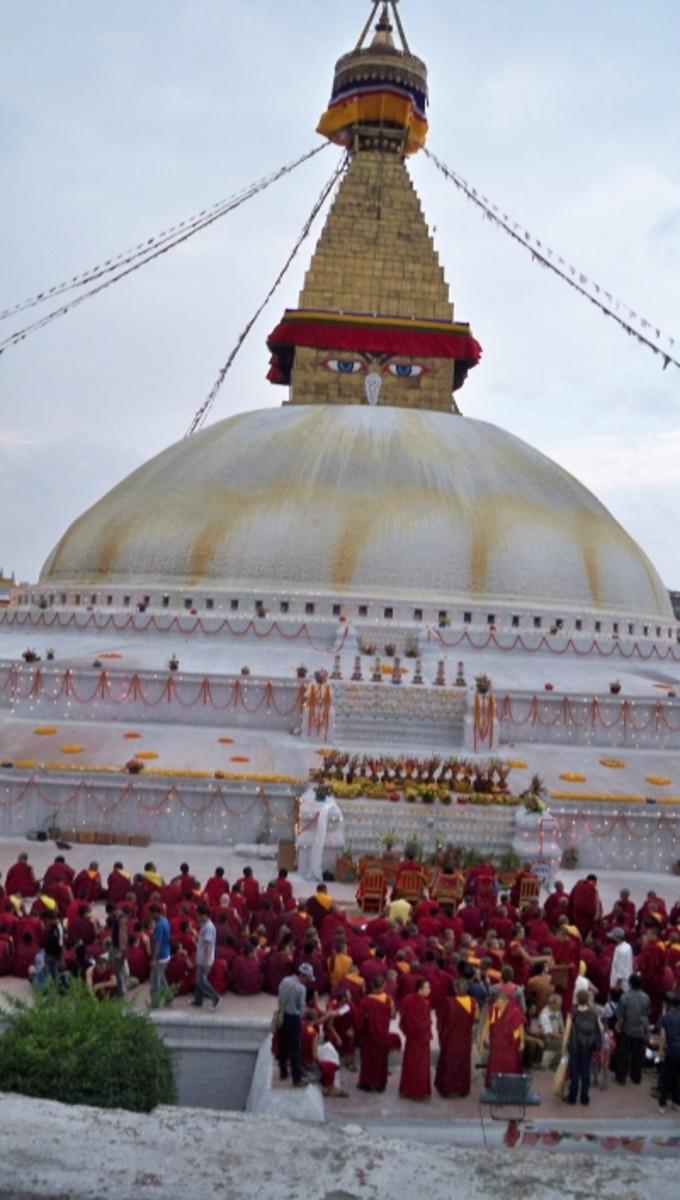 Buddhist monks worshiping at Boudha stupa