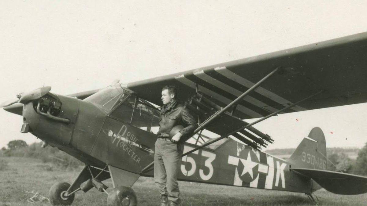 "Charles ""Bazooka Charlie"" Carpenter by his plane"
