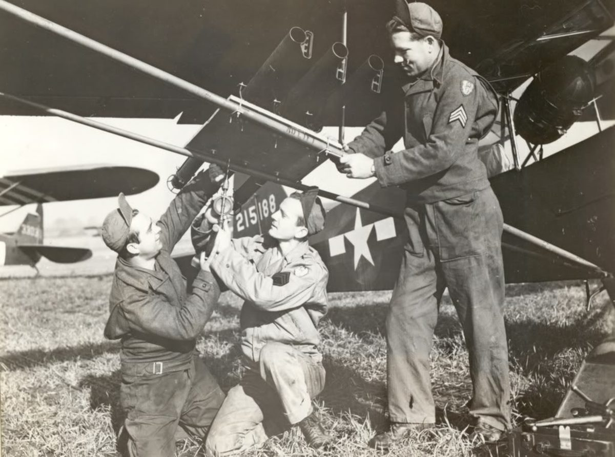 """The bazookas on Charles """"Bazooka Charlie"""" Carpenter's plane being loaded"""