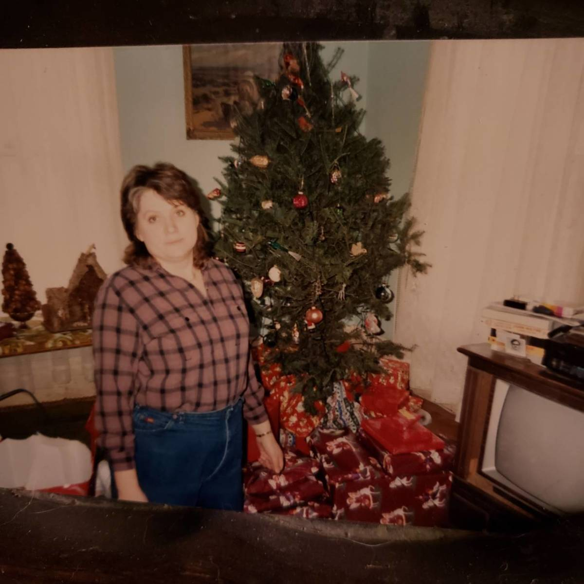Connie next to Christmas tree and gifts.  Probably Christmas 1985.