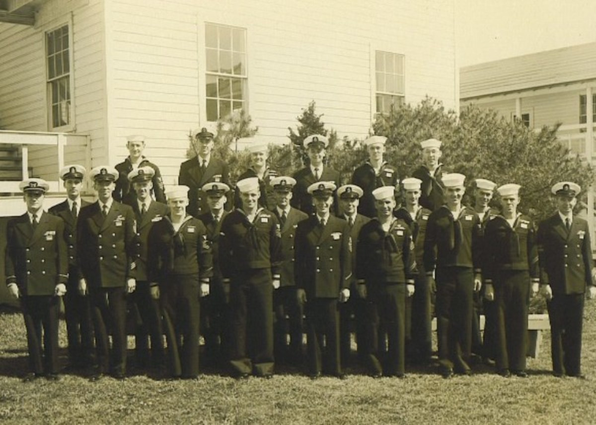 B. Moore is at the far right side of the photo.