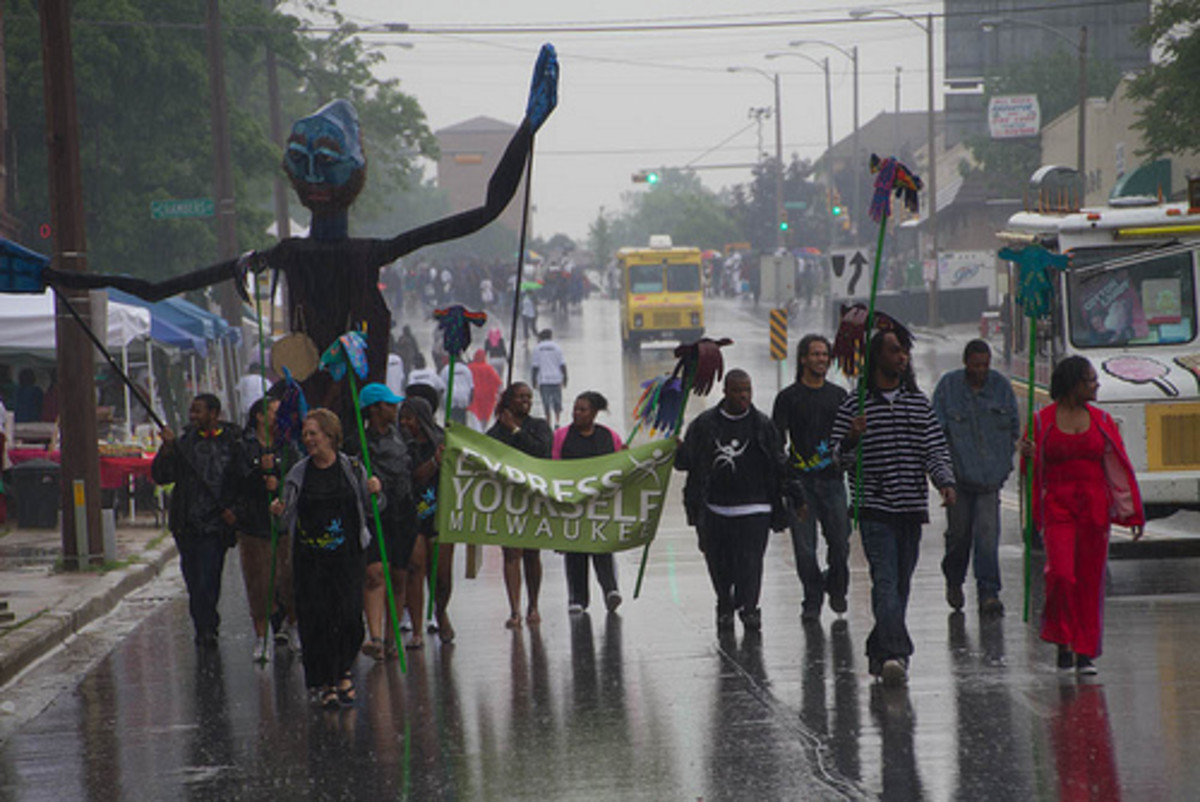 Participants in a 2011 Juneteenth parade in Milwaukee march through the rain.