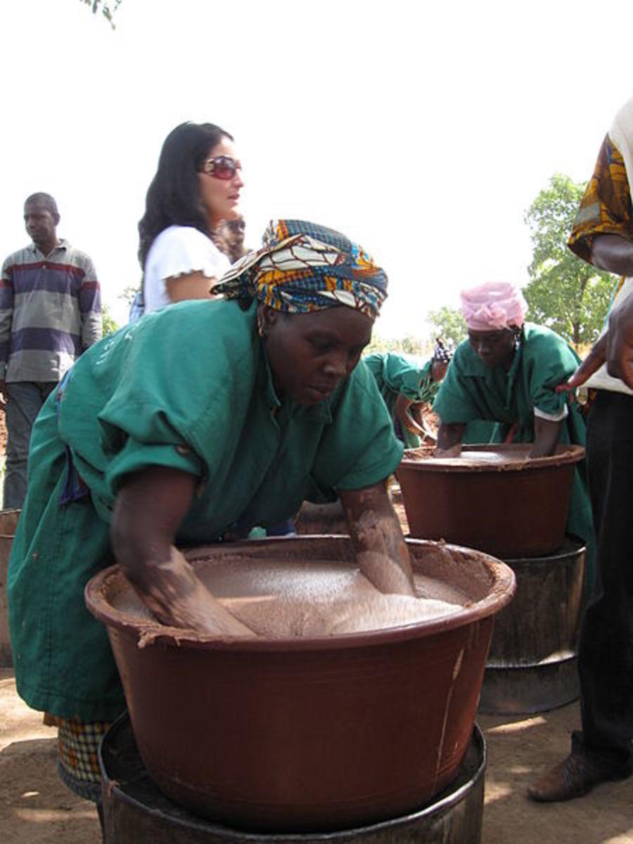 women working to extract shea butter