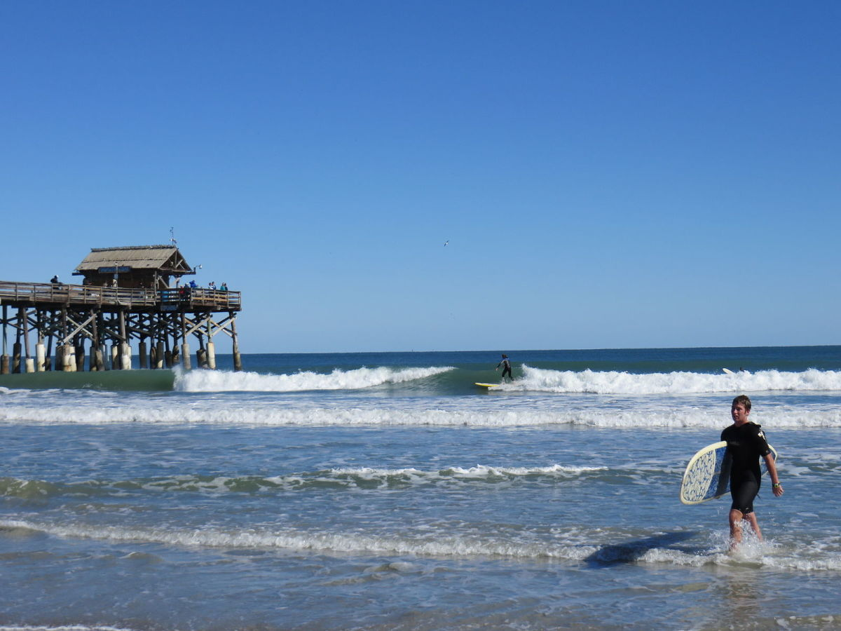 Cocoa beach is a hot spot for surfers, swimmers, and loungers of all kinds.