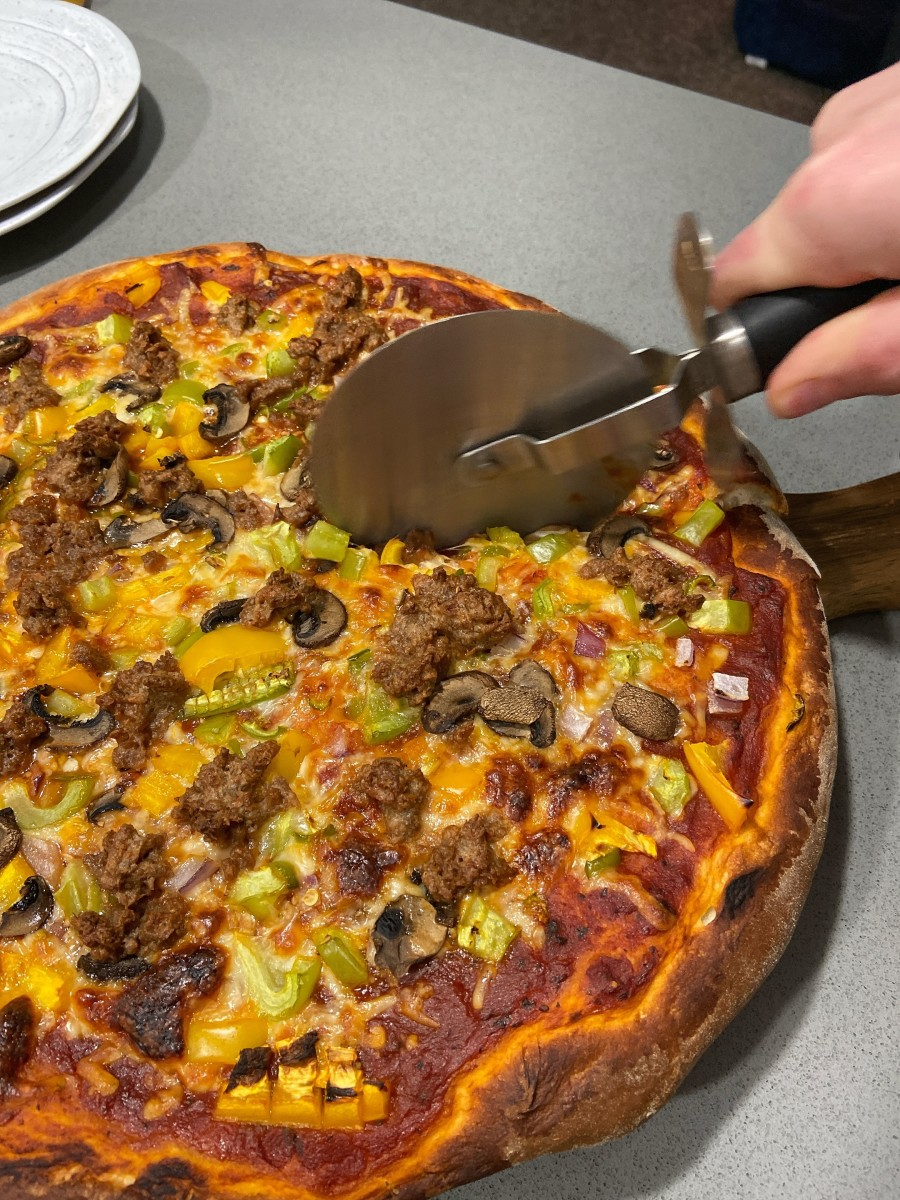 Slice the pizza with a pizza cutter and serve.
