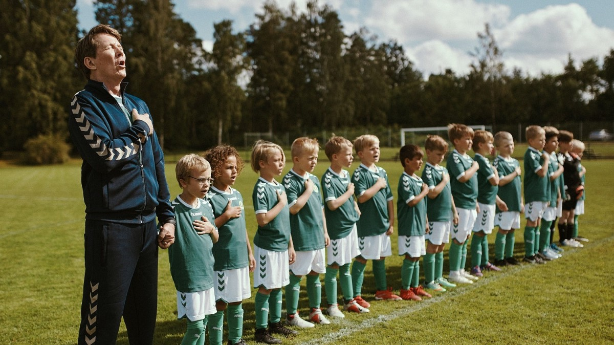 Tommy (Thomas Bo Larsen) and the soccer team that he coaches.