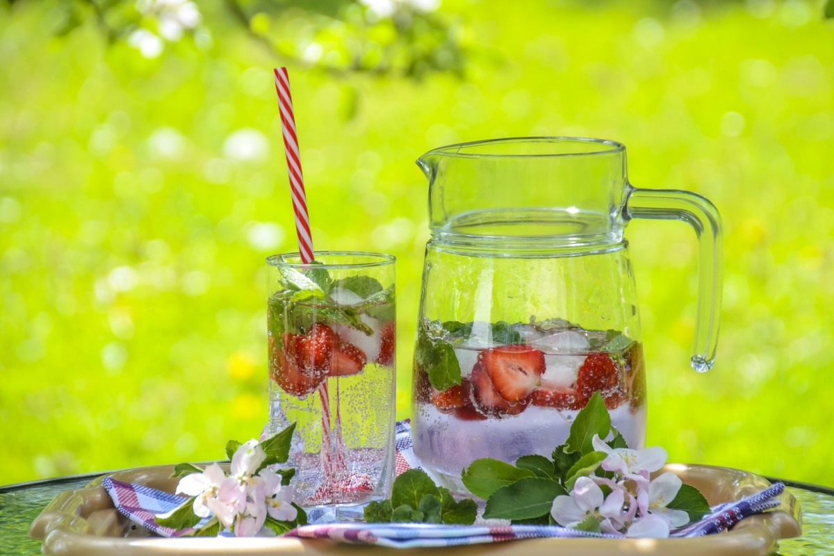 Iced water with strawberries and fresh mint leaves
