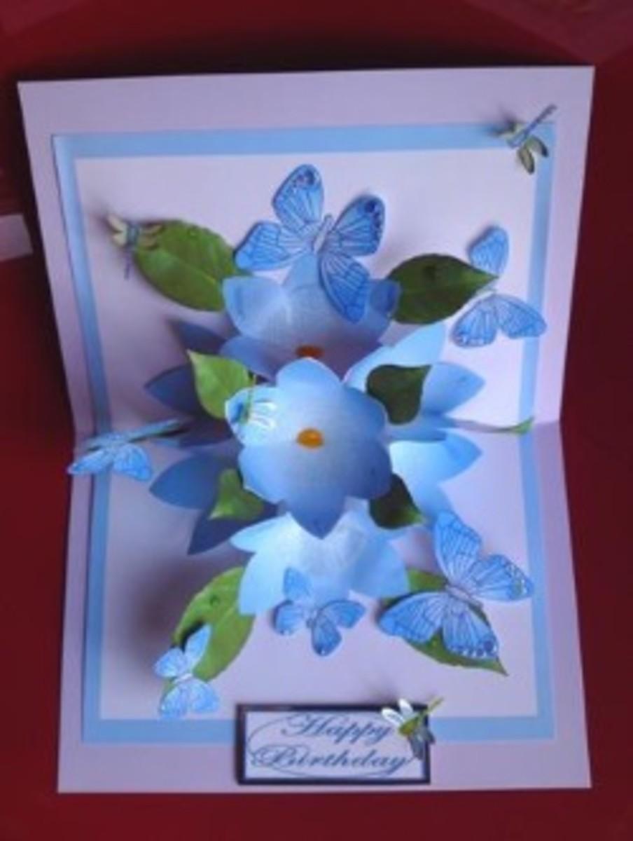 Blue 3D flowers and butterflies