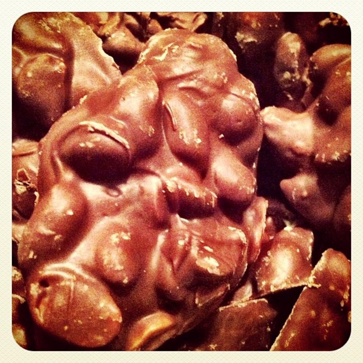 Chocolate covered peanut or raisin clusters.