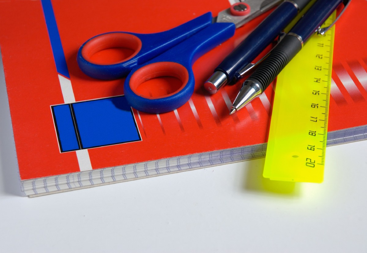 A pair of scissors, pencil, ruler the basic stationary you will need