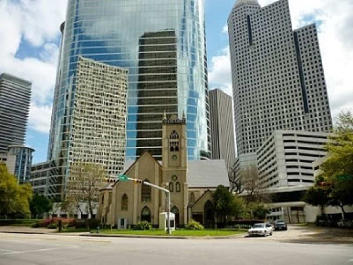 Church with the tall buildings as a backdrop in downtown Houston, Texas