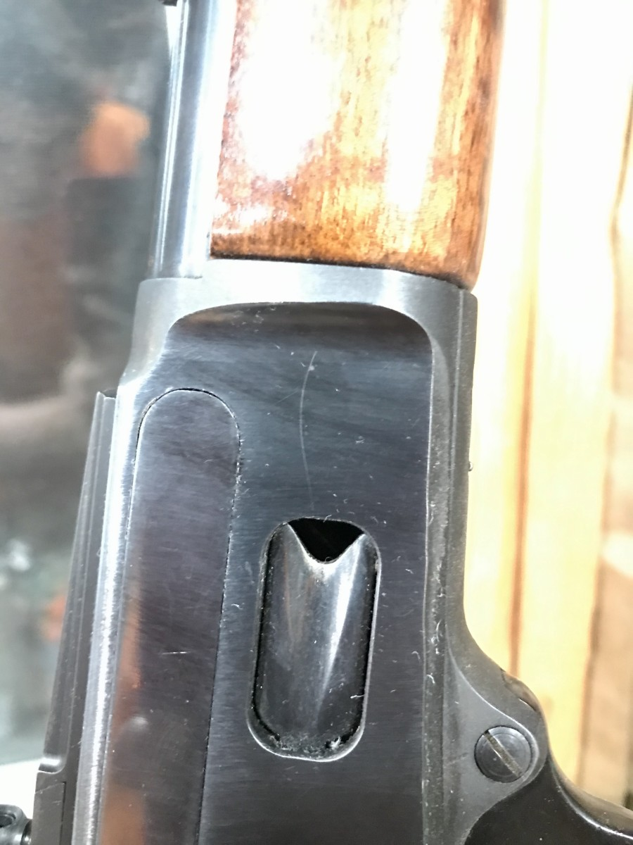 The ugly scratch on the receiver ahead of the loading gate.