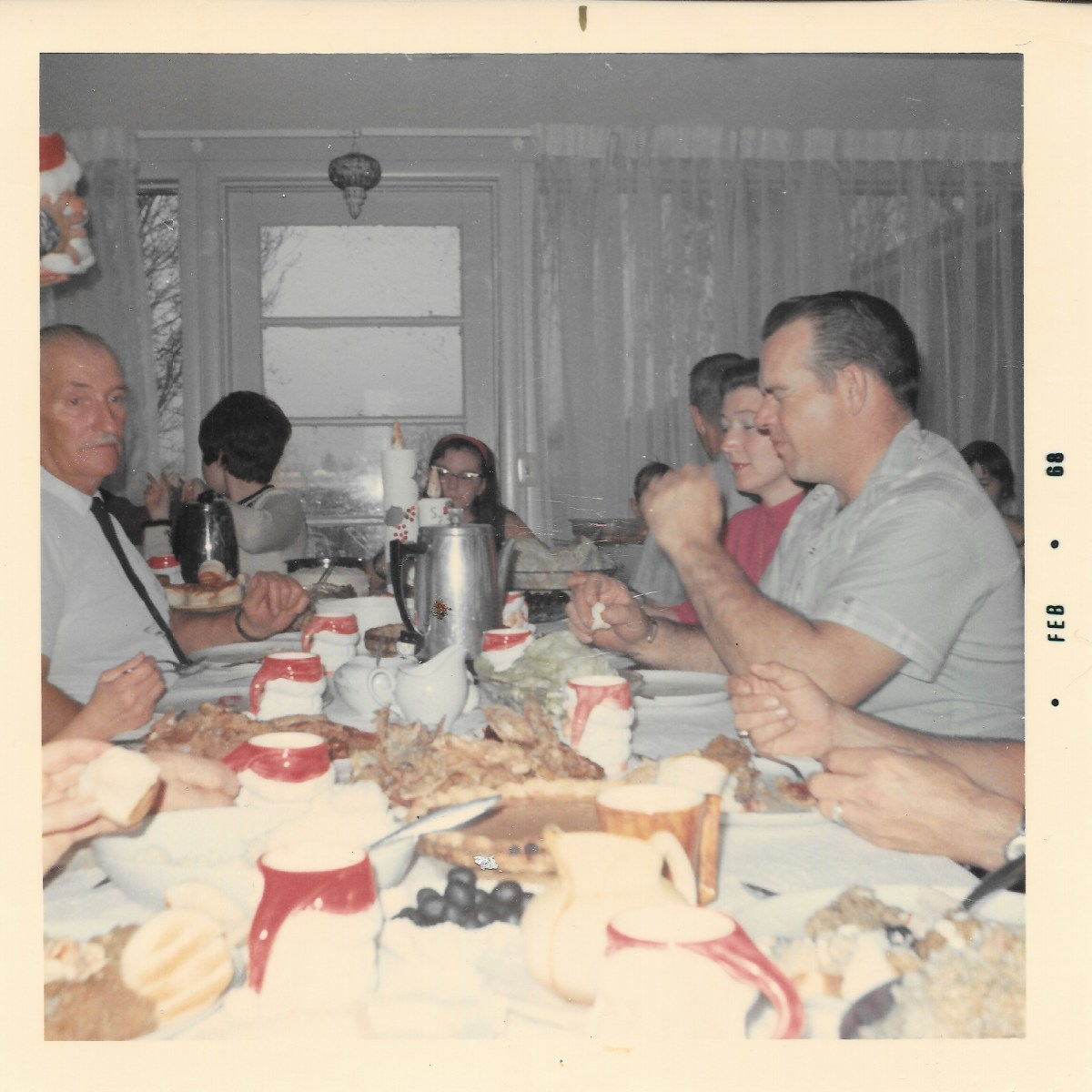 My dad and mom are on the right. I'm at the end of the table.