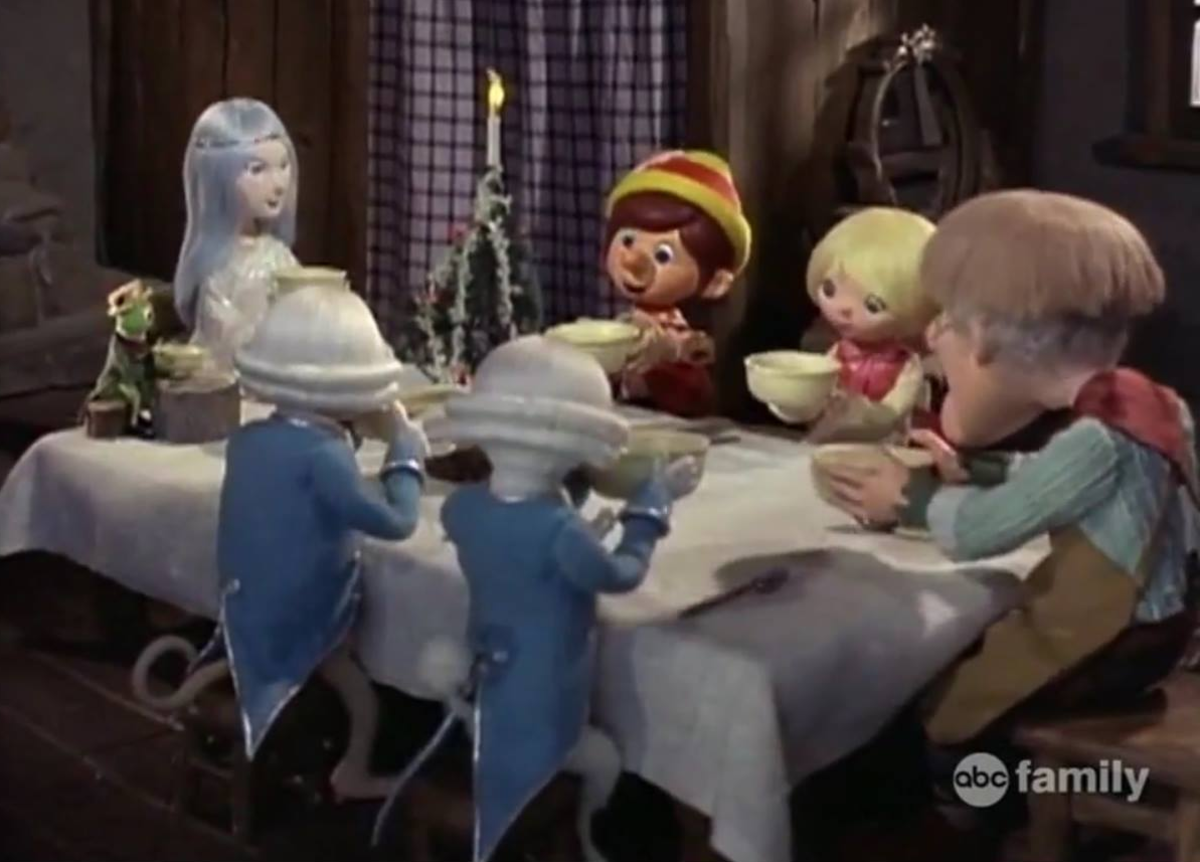 Pinocchio with his family and friends at Christmas breakfast.