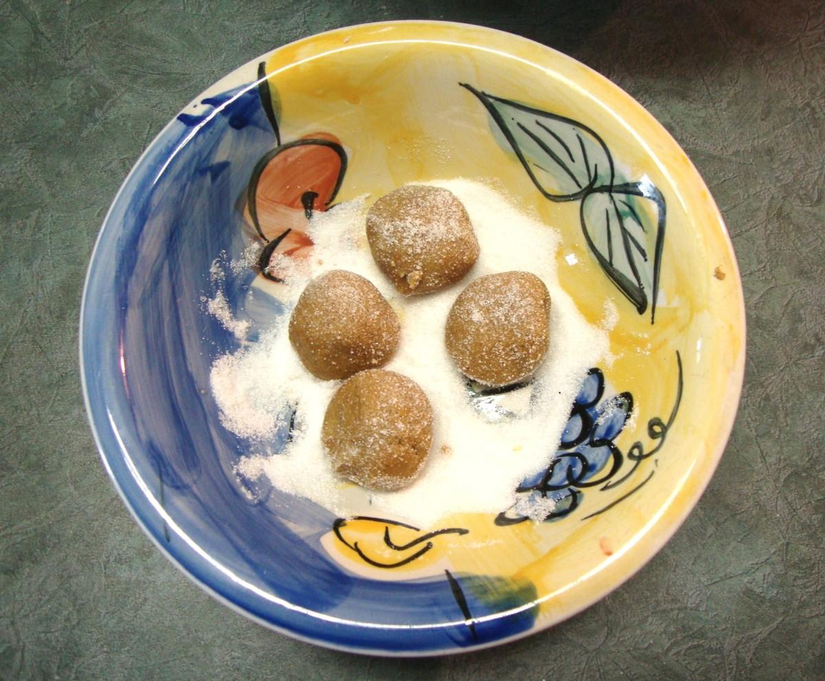 Image: Rolling Cookies in Sugar