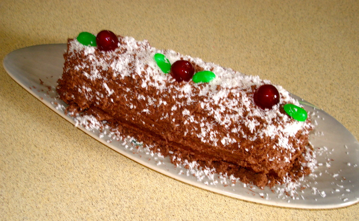 The Yule Log Decorated with Glacé Cherries and 'Leaves' Made from Jelly Beans