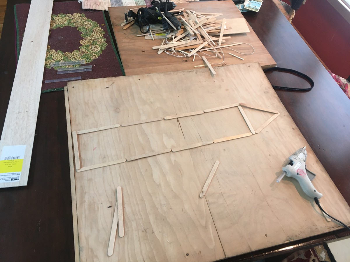 By laying out the ship's popsicles without glue one gets a better sense for what sort of proportions one is working with.