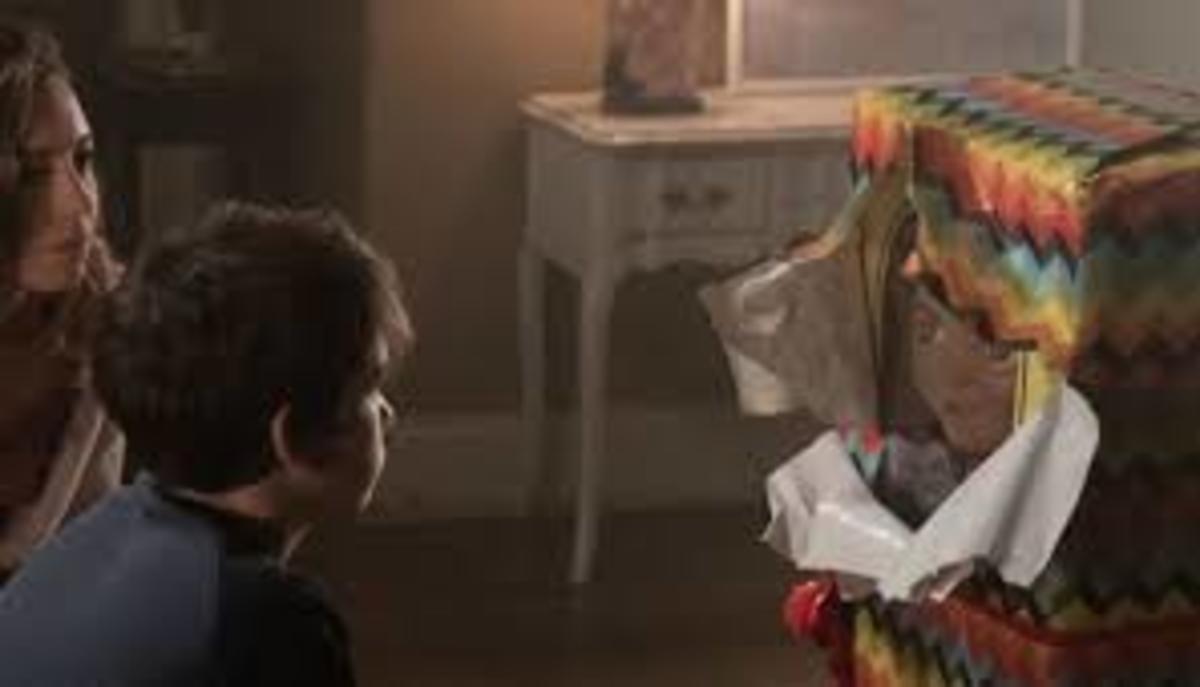 Karen and Andy unwraps the Buddi doll box