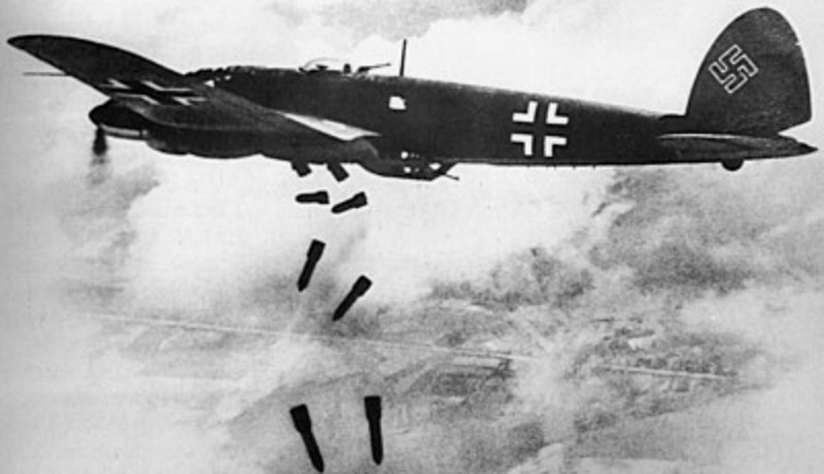 A German Heinkel He 111H bomber dropping bombs.