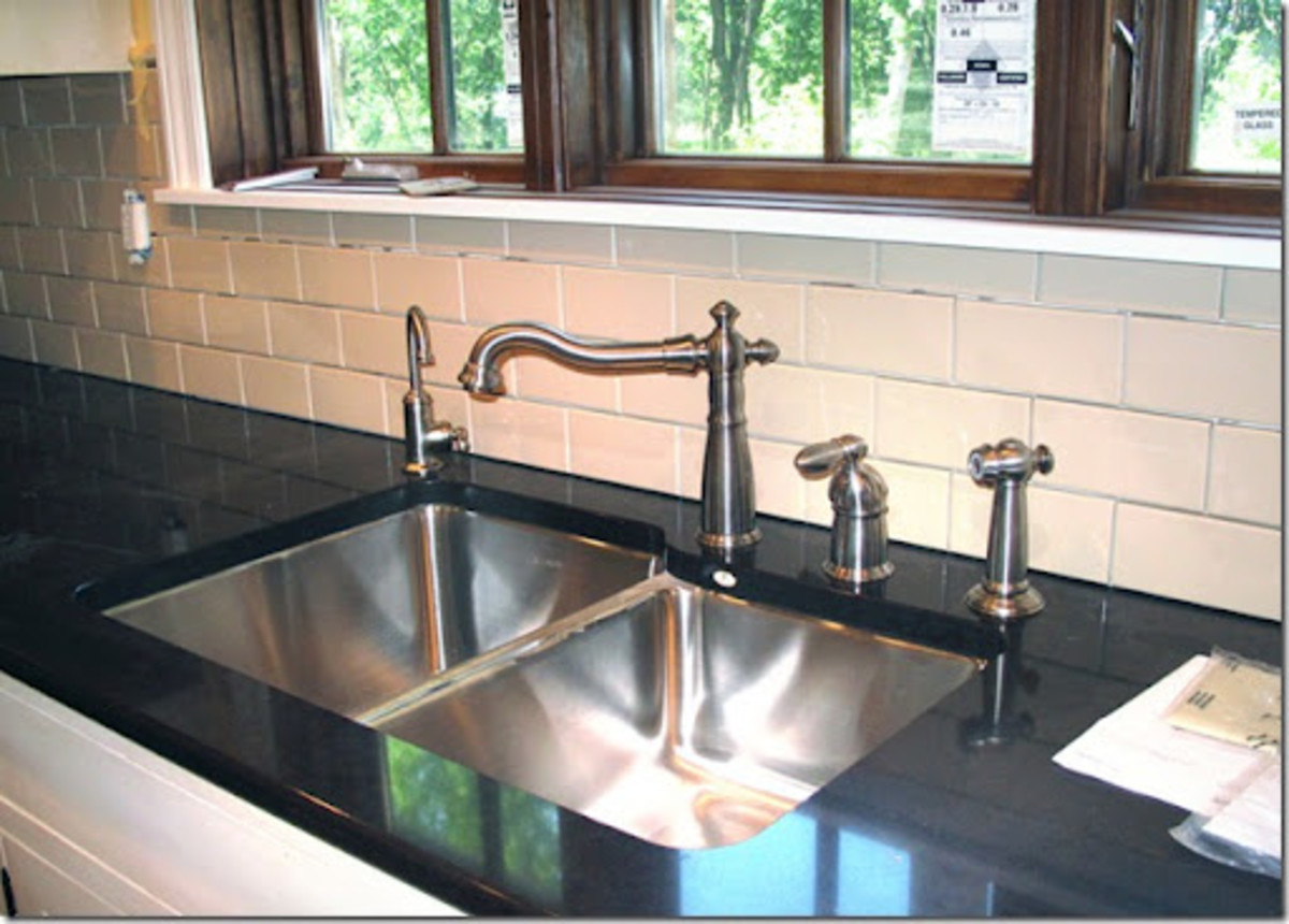 Beautiful food preparation sink and faucet with filtered water mounted under the kitchen counter top