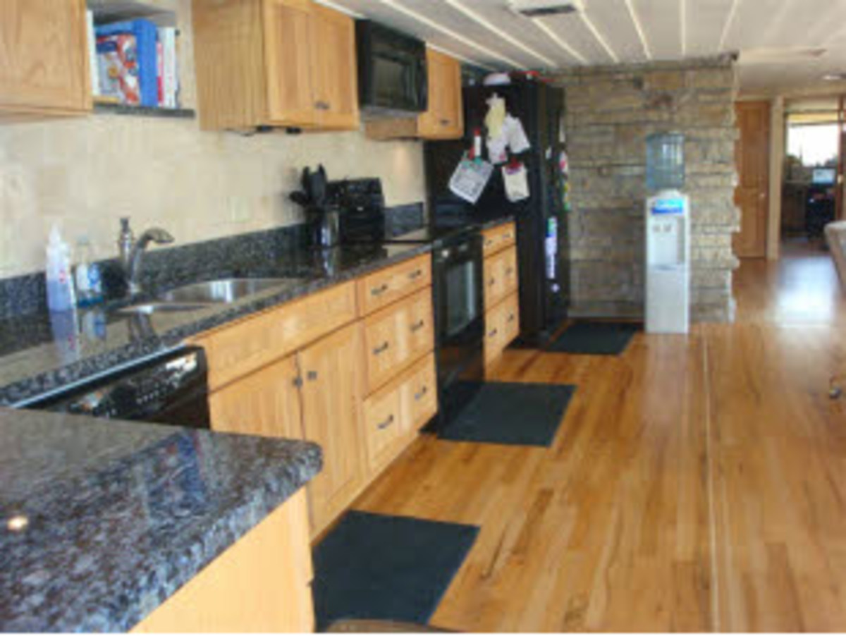 beautiful kitchen with wood flooring and a plastic drinking water fountain