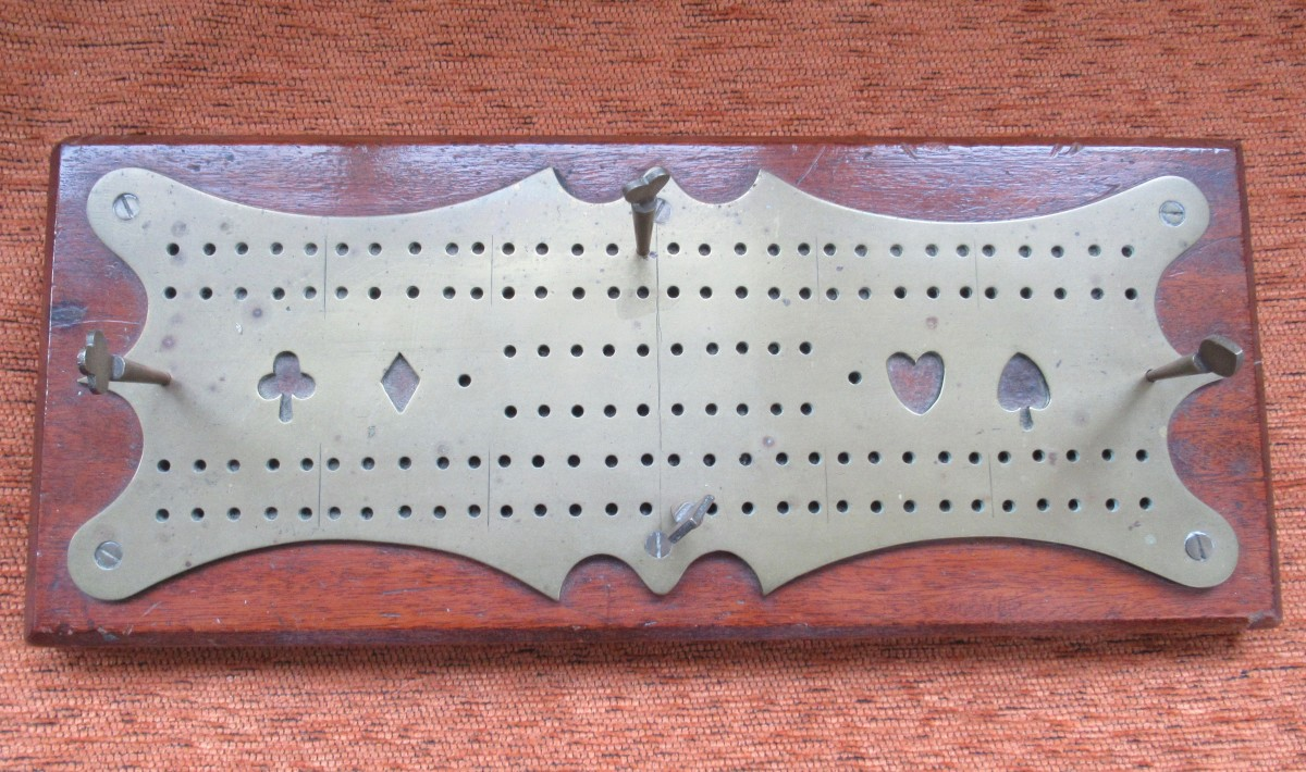 Family History in Objects: Cribbage Board; Bamboo Shaker; 1914 Christmas Box; Victorian Miniature Coin Box