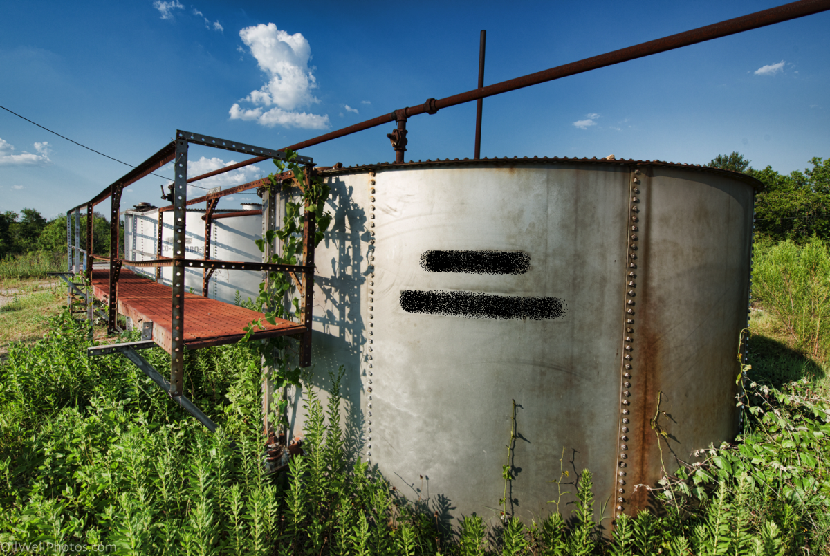 Abandoned oil well tanks such as this one pose a danger to children and wildlife, which may fall in and become trapped.