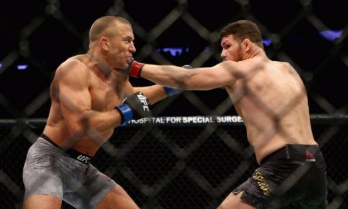 Georges St-Pierre (left) during his fight against Michael Bisping (right).