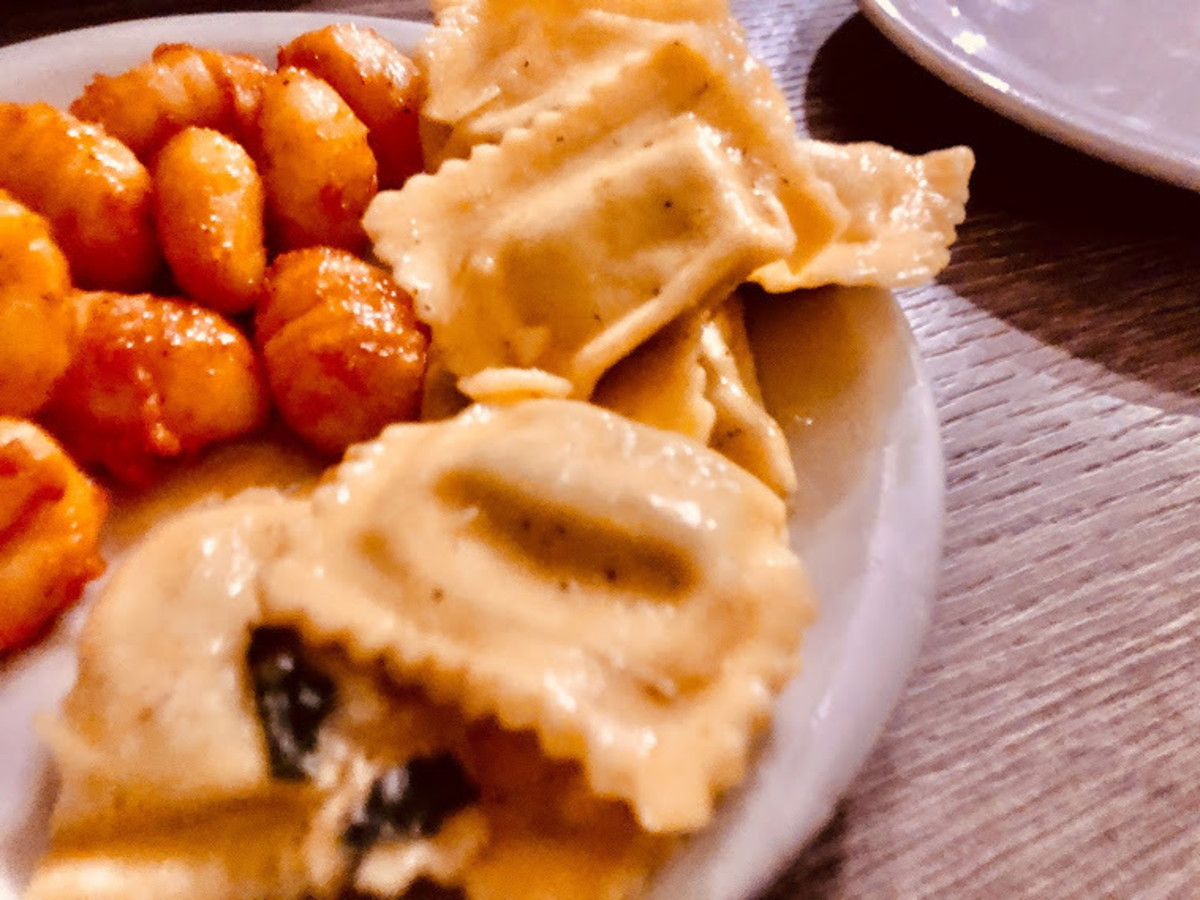 A combo dish with Italian potato gnocchi and ravioli filled with ricotta cheese & spinach