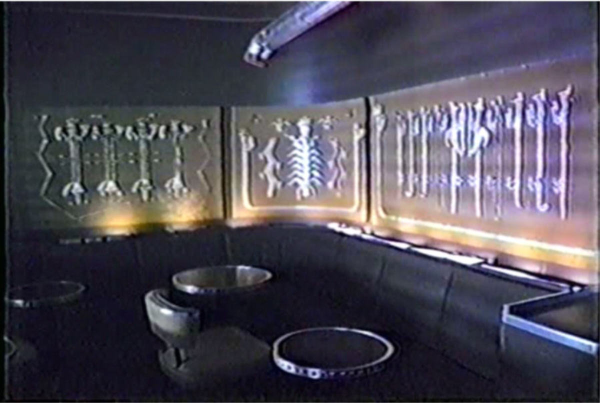 The booth and tables are typical of the modern style that was popular in that era. Since no flammable material or wood was allowed on board, the glass and chrome decor was ideal.