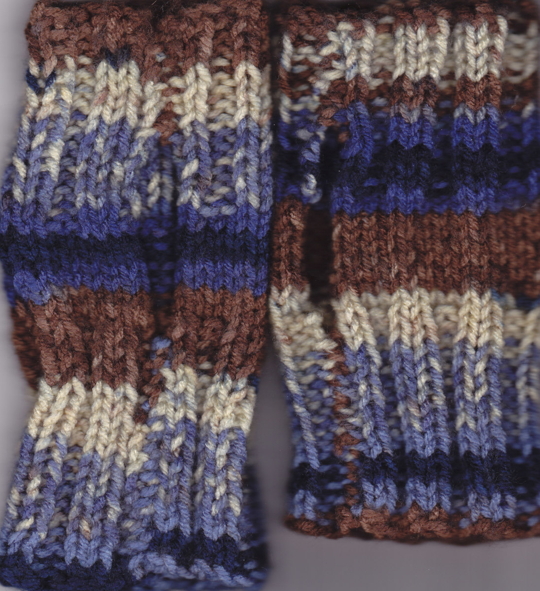 Shows opening/sewn parts above and below the thumb hole. Some Ombre yarn self-stripes.