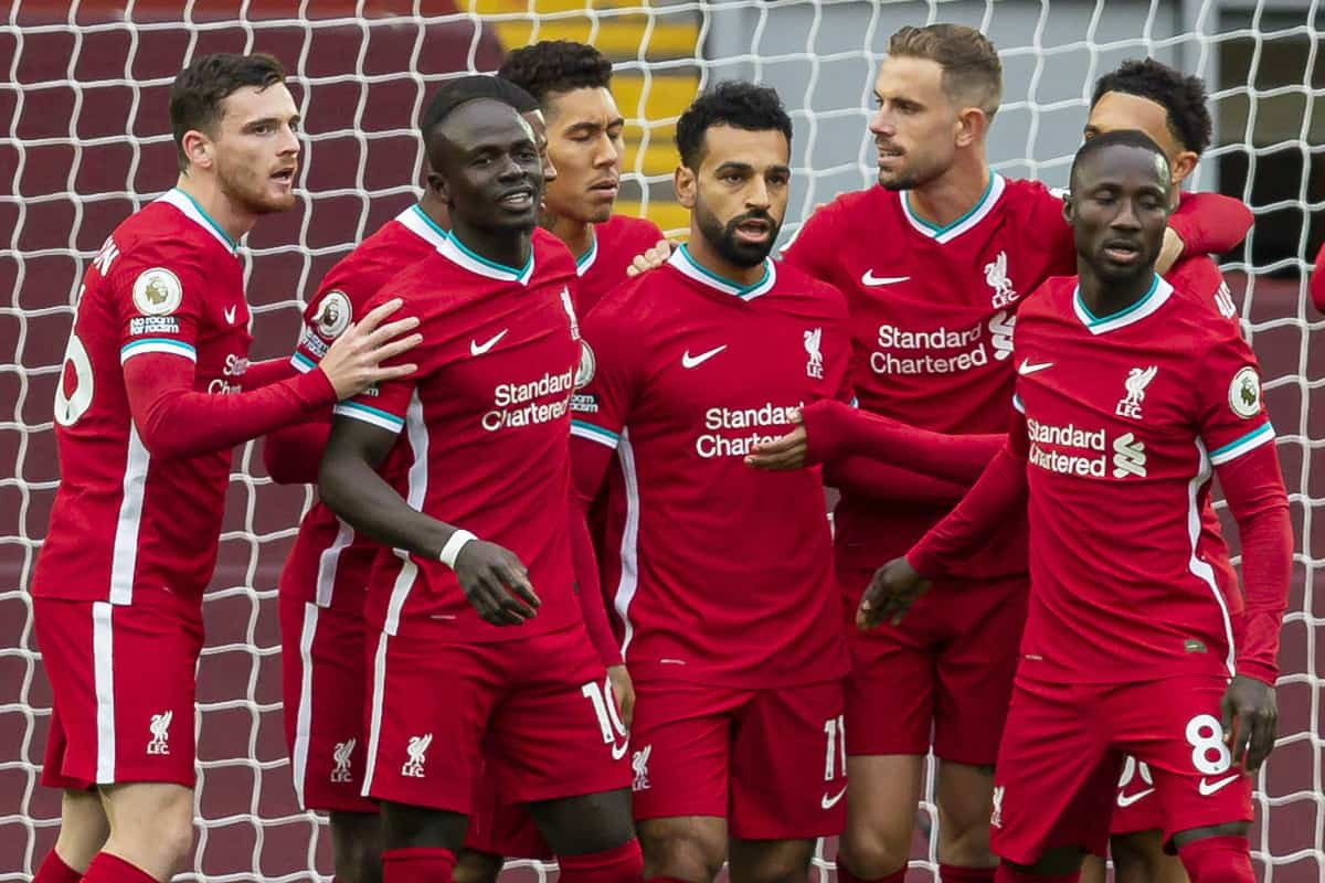 Liverpool FC players celebrating after a goal against Leeds United FC.