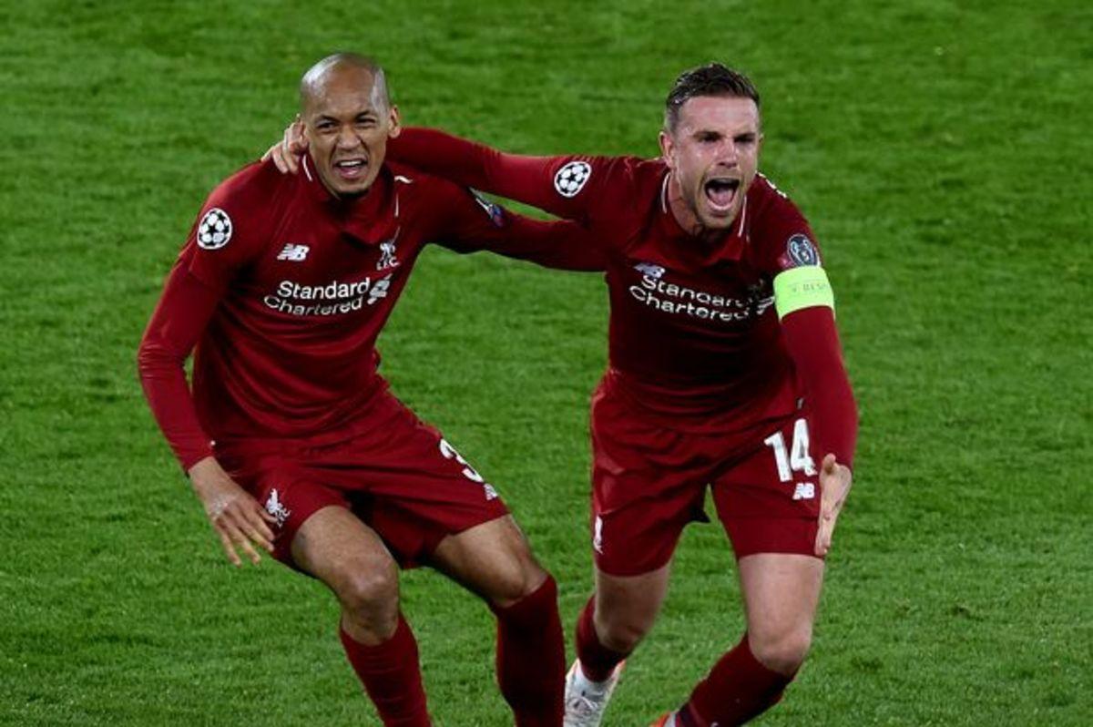 Fabinho (Left) and Jordan Henderson (Right) celebrating a goal.