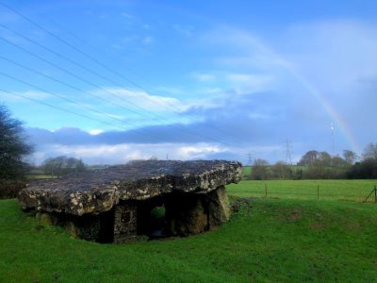 A rainbow emerging above the Tinkinswood Burial Chamber.