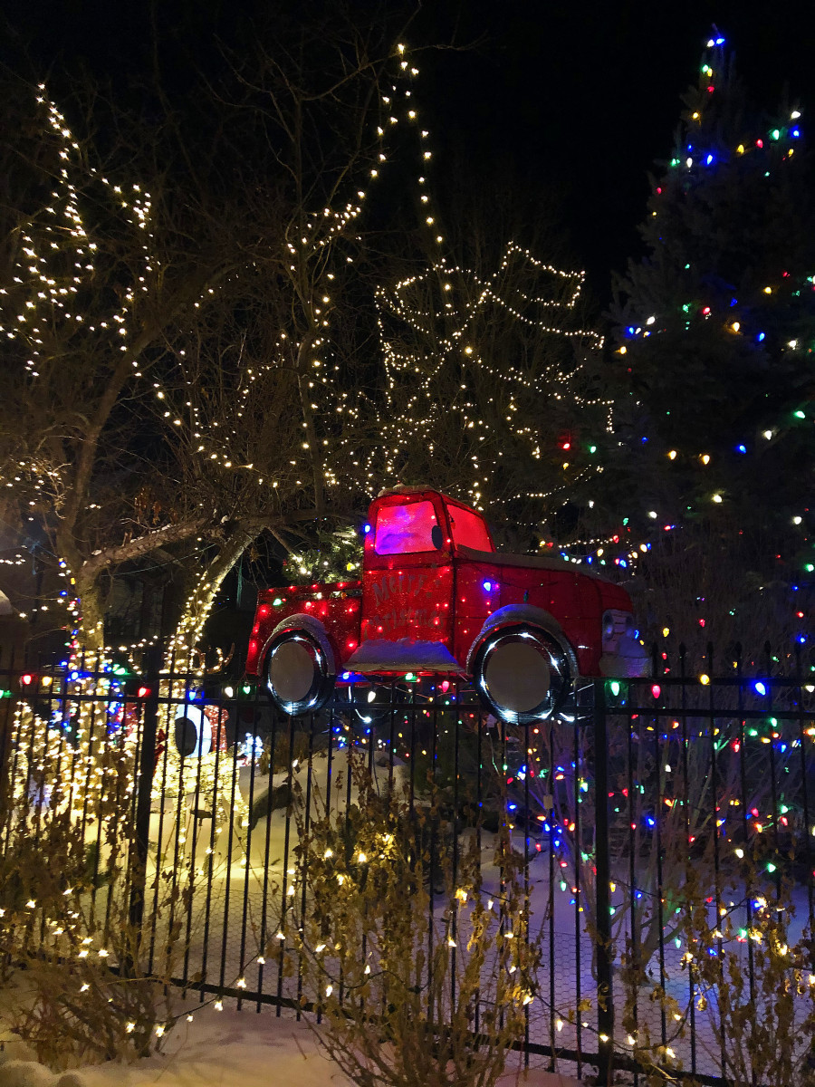 Here I focused on just one aspect of the decorations, a little red truck situated in front of the gates.