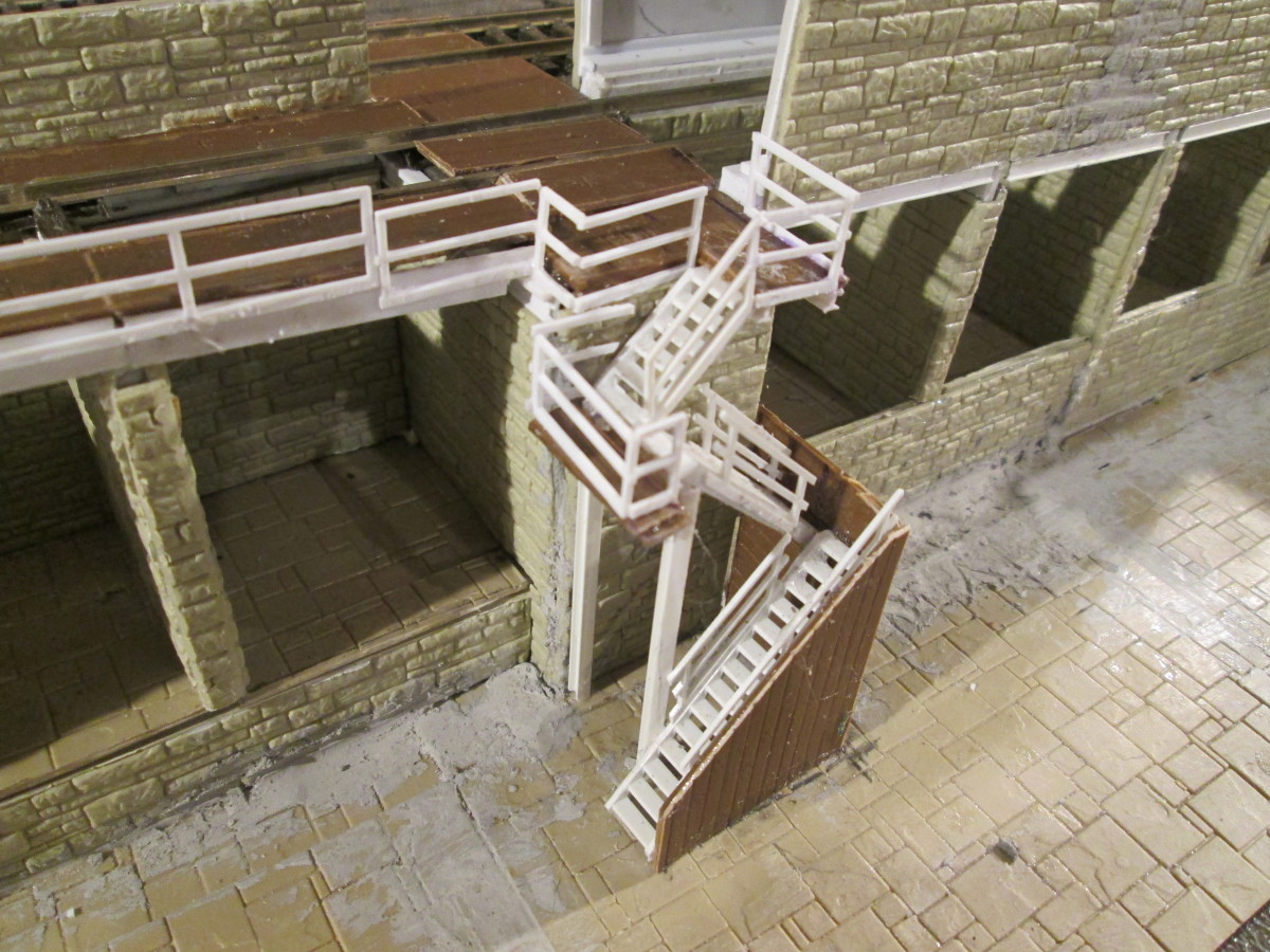 Completion of the stairs, handrails (Plastruct 90682 Straight, and SRS4 Diagonal) completed including landing