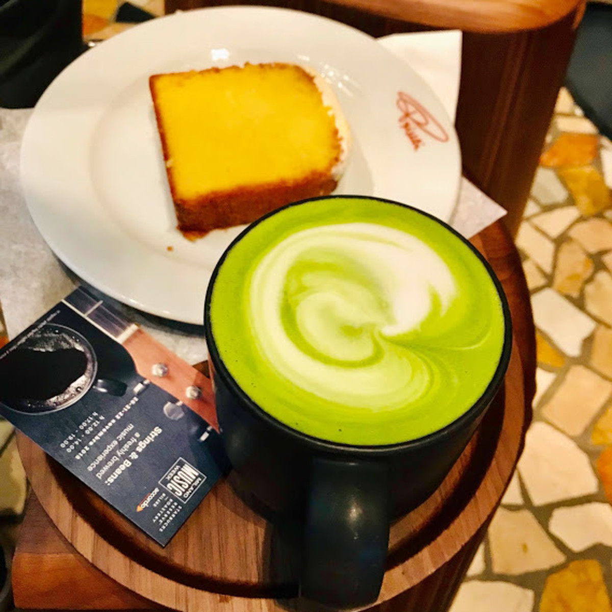 A matcha cappuccino and a lemon plumcake at the Starbucks Reserve Roastery of Milan