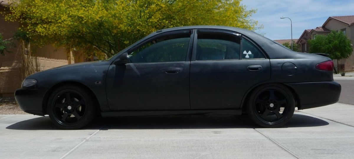 Bryan Patrick Miller's matte black Ford Escort, possibly similar to the dark four-door vehicle seen in surveillance footage within minutes of Adrienne Salinas's disappearance