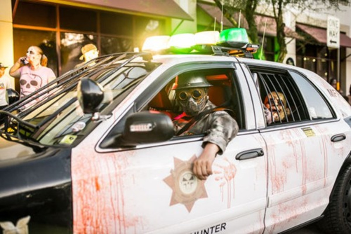 Zombie Hunter Bryan Patrick Miller is his decommissioned police car
