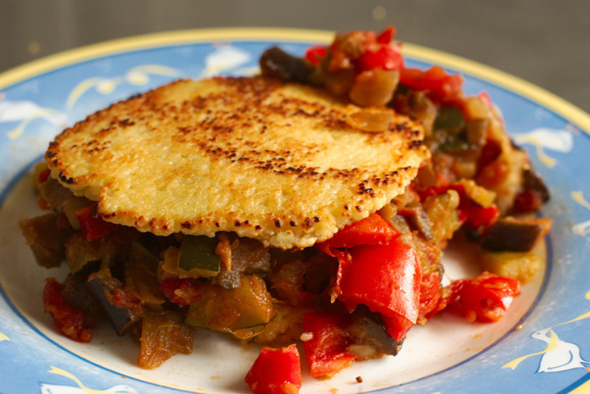 Vegetarian Sandwich made with roasted eggplant and red peppers on couscous bun