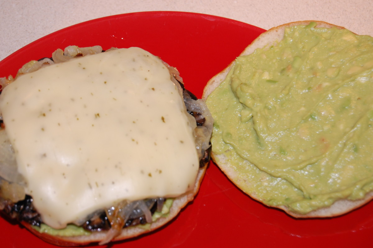 Portabella sandwich made on Oraweat sandwich thins with avocado, caramelized onion, garlic herb cheese, and portabella cap