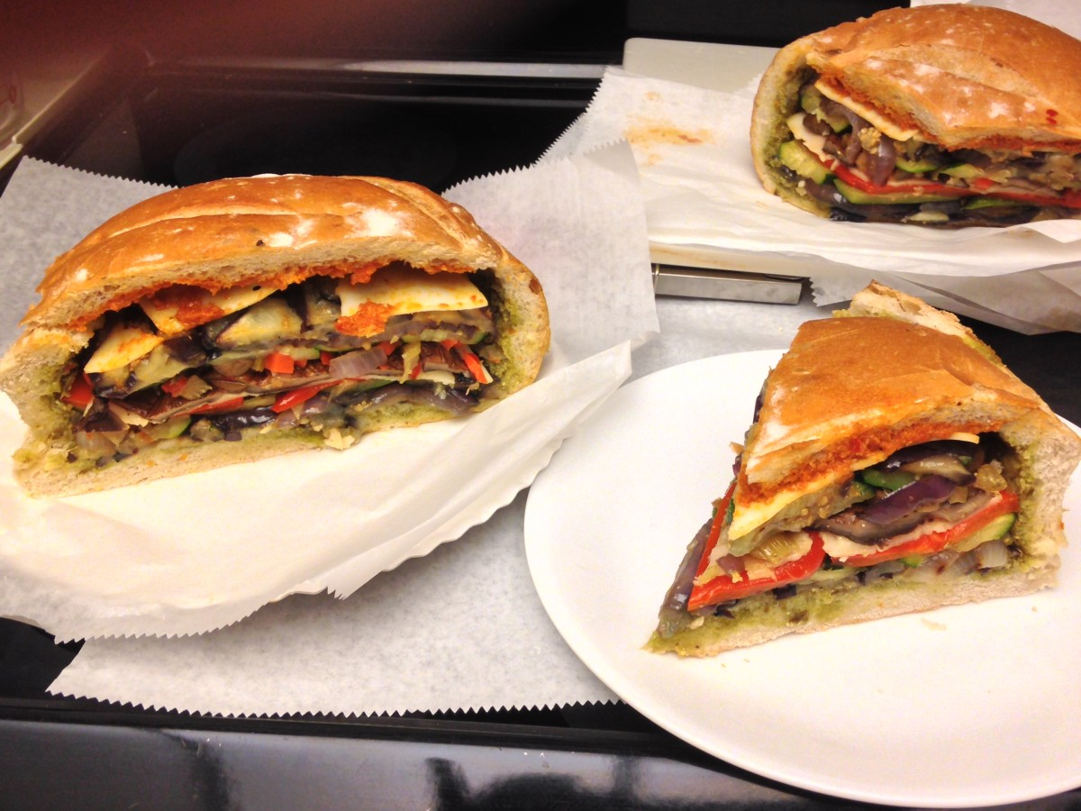 Vegetarian Muffuletta Sandwich with grilled eggplant, zucchini, purple onion, red pepper, and portabella mushrooms