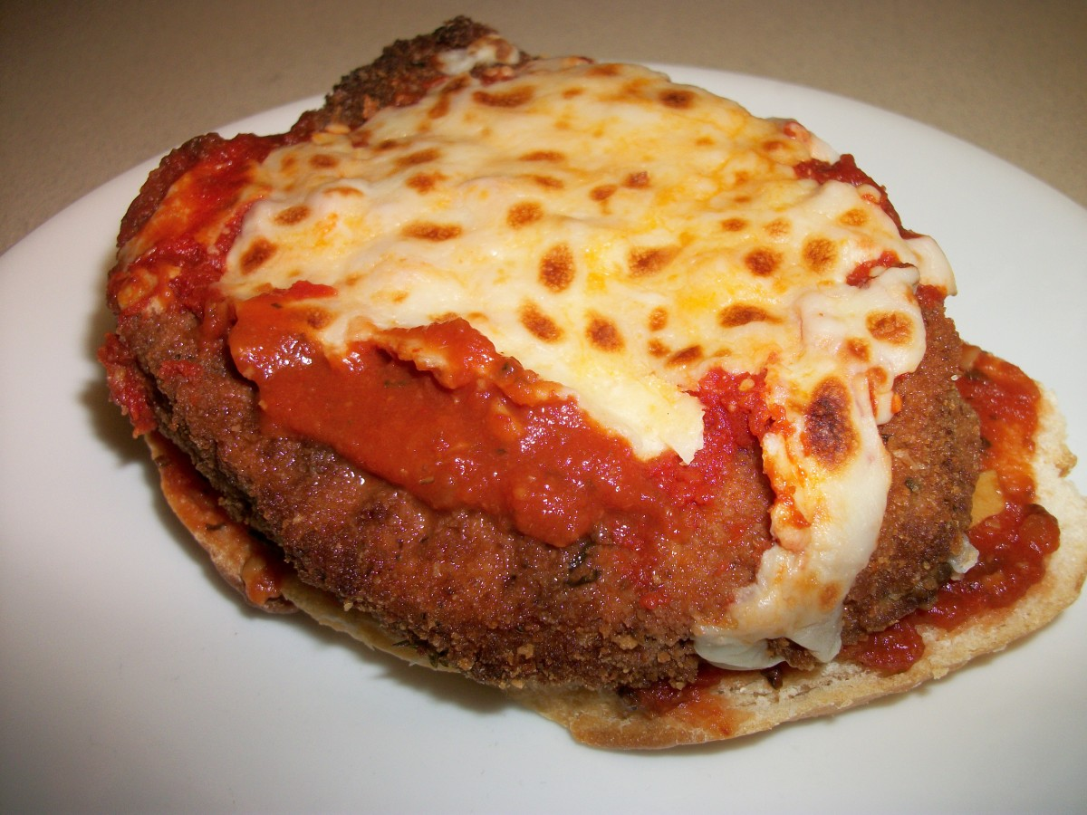 Eggplant Parmesan Sandwich- place on garlic bread with sauce and Mozzarella