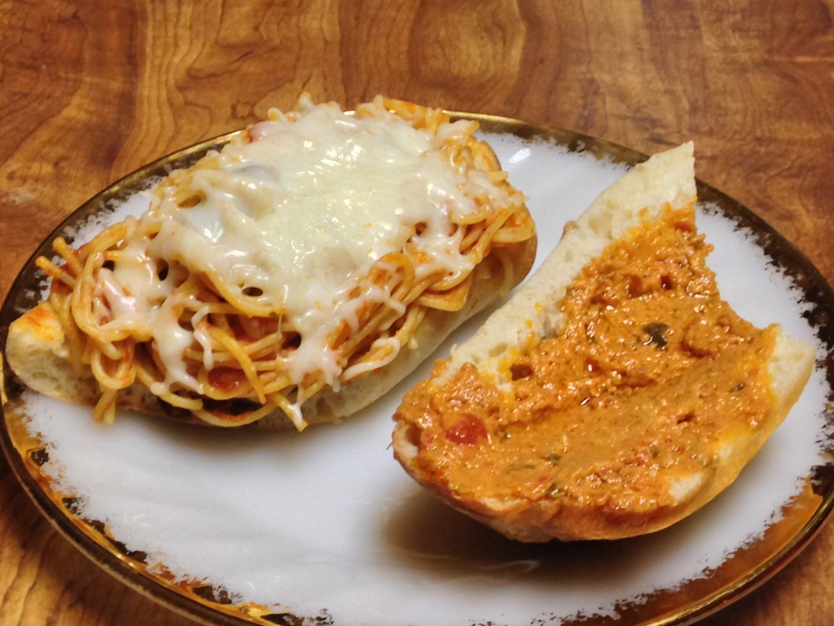 Spaghetti topped with cheese on the left, bread with sundried tomato pesto on right