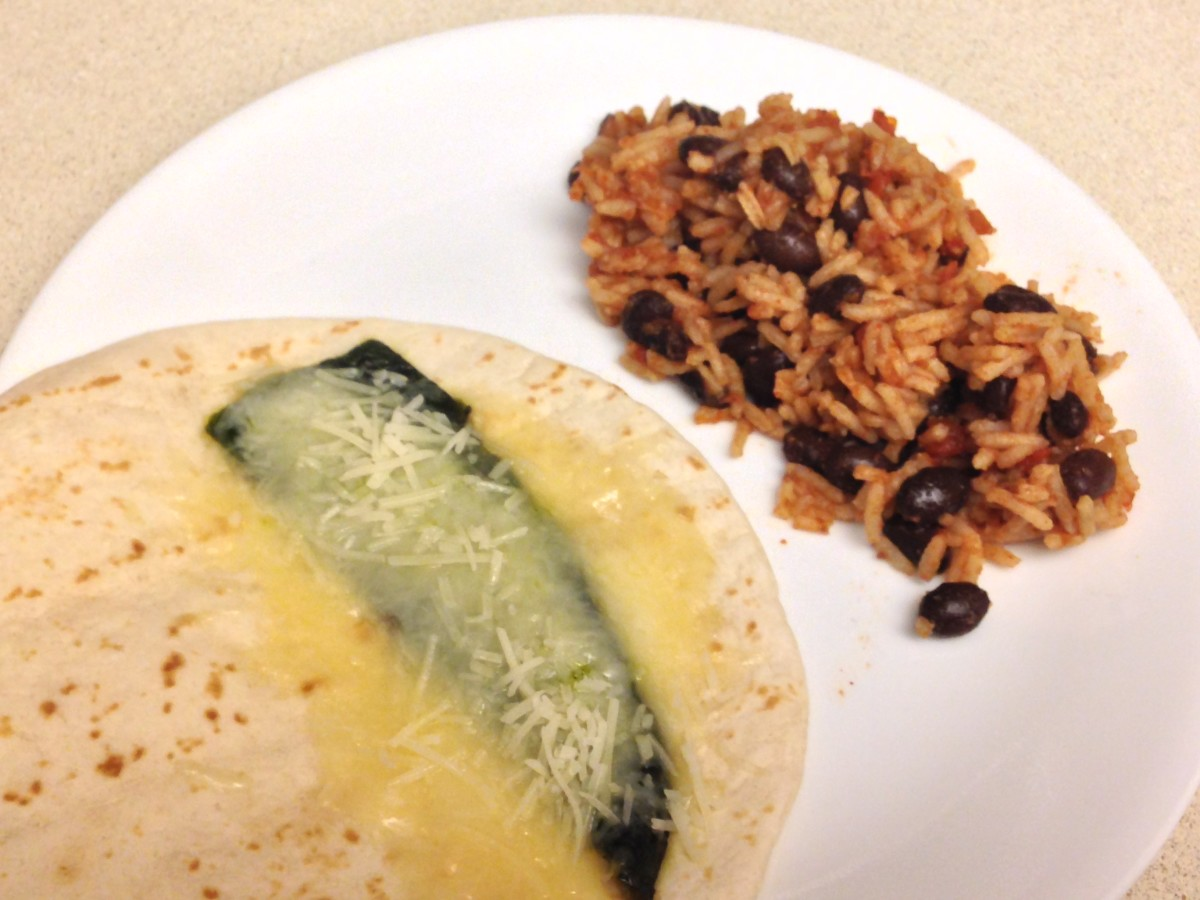 Wrap with Poblano Pepper with Monterrey Jack Cheese, served with Taco Beans & Rice